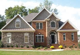 brick home exterior stunning luxury with turret and arched entry