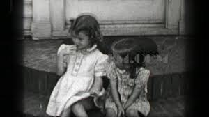 1939 young girls sitting front porch stoop with wavy curly long
