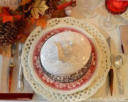 a fall thanksgiving table setting and tablescape with a turkey