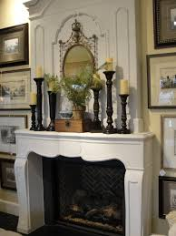 mantle decor with a white brick fireplace providing the perfect