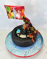 novelty floating tyre cake blue underlighting angie scott cakes