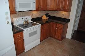 maple cabinets tan brown granite tile blacksplash vinyl floors