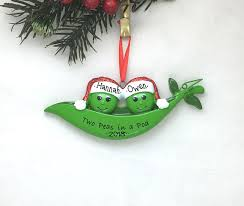 two peas in a pod christmas ornament two peas in a pod with christmas hat s ornament