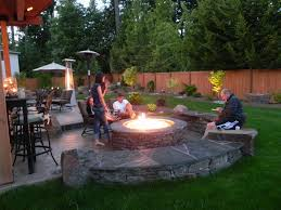 Front Yard Patio Furniture Large Fire Pit With Stone As A Seat Also Plants