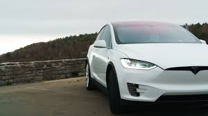 tesla electric car tesla model x 75d drops base price to 79 500 roadshow