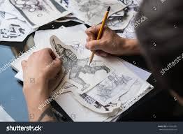 tattoo artist draws sketches tattoo guy stock photo 619324205