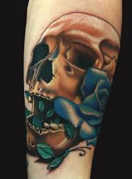 skull with a blue rose growing out the mouth by aric taylor nice
