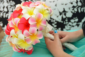 wedding flowers hawaii hawaii wedding flowers pink yellow plumeria bouquet