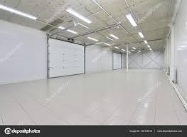 empty parking garage warehouse interior with large white gates