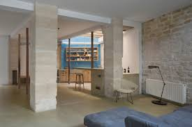 small budget renovation reveals a loft s parisian charm paris loft renovation living area columns
