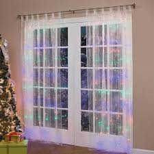 curtain tree lights decorate the house with beautiful