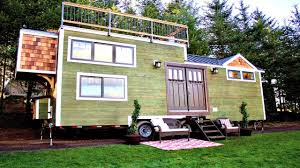 modern craftsman tiny house with automated staircase and roof deck