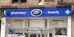 shop boots pharmacy boots pharmacy sign above the byres road glasgow shop stock photo