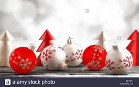 christmas ornaments balls paper trees on a wooden table in front