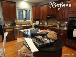 kitchen redo with white painted cabinets and tile backplash 11