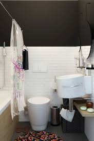 apartments small bathroom design with black and white subwaytile