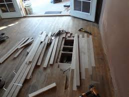 Hardwood Floor Removal Damaged Wood Flooring Planks Removal And Reinstallation From