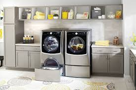 contemporary laundry room cabinets aristokraft cabinets for a contemporary laundry room with a white