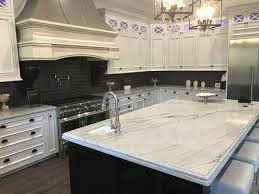 white sink black countertop blue pearl calcutta gold granite caountertops white marble single