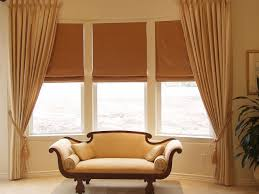 interior bay window drapes ideas with banquette seating pillows