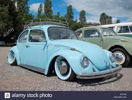 blue volkswagen beetle vintage a lowered vw beetle with roof rack and luggage at the viva skeg