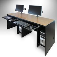 dt series basic computer desks by smartdesks shown with grommet mouned monitor arms