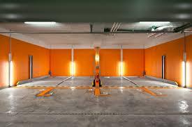modern futuristic design the garage storage interior that has awesome orange and white nuance the garage storage interior that has grey modern granite floor design