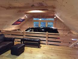 partial loft in our 1 1 2 story barn open to car lift bay below