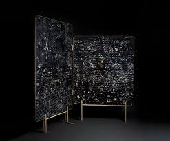 marcin rusak surfaces furniture by suspending florals in resin
