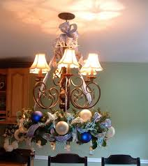How To Decorate A Chandelier A Whole Bunch Of Christmas Chandelier Decorating Ideas U2014 Style Estate