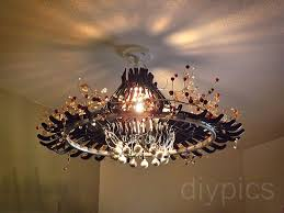 How To Make A Cardboard Chandelier Make A Chandelier Out Of Hangers Candelabro Feito De Cabides