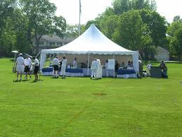 chicago tent rental pole tent with tables and table linens from house of rental party