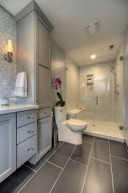 master bathroom with glass walk in shower large gray tiles on