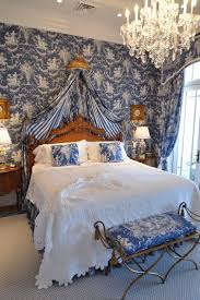 blue toile bedroom again adding warm wood tones to blue and white