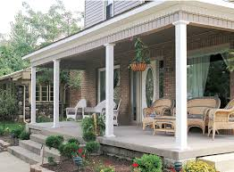 outdoor wicker furniture and natural stone wall porch