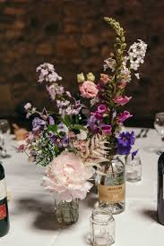 Table Flowers by Centre Pieces In Whisky And Gin Bottles Tables Names After