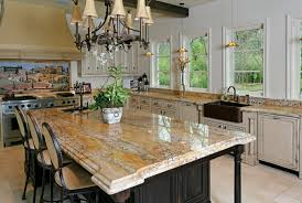 brown granite countertop with waterfall edges on black wooden