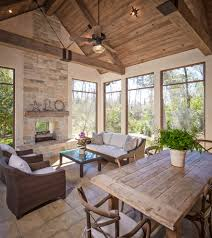 double sided fireplace porch traditional with sitting area