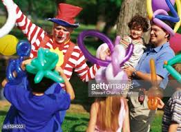 clowns for a birthday party clown entertaining children sitting on the grass at a birthday