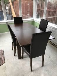Cushioned Chairs Extending Dining Table With 4 Cushioned Chairs Good Condition