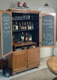 an old armoire turned into a bar did this project as a gift for