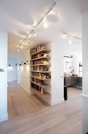 i love the wall lights and interesting use os shelves rather