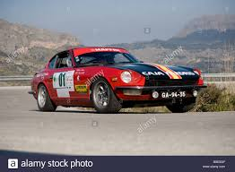 vintage datsun red 1970 datsun 240z racing in the classic car rally mallorca