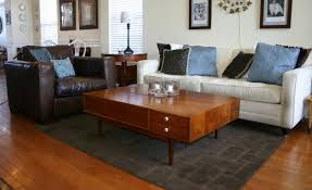 Size Of Rug For Living Room Proper Sizing For A Living Room Rug Before And After