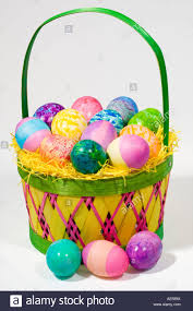 filled easter baskets straw easter basket filled with eggs of different colors and