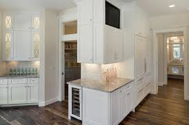bm simply white on kitchen cabinets angled kitchen with white granite countertops