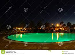 luxury swimming pool night scene stock photos images u0026 pictures