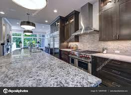 modern kitchen with brown kitchen cabinets u2014 stock photo