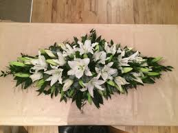 white lily 4 u0027 funeral coffin spray created by willow house