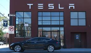 tesla boosts range of all electric model s to 335 miles wsj